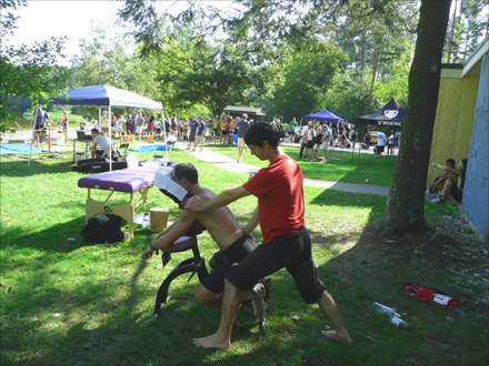 Alexandre Pazmandy is giving a chair massage at the Check for Change Triathlon in Chicopee, in August 2012